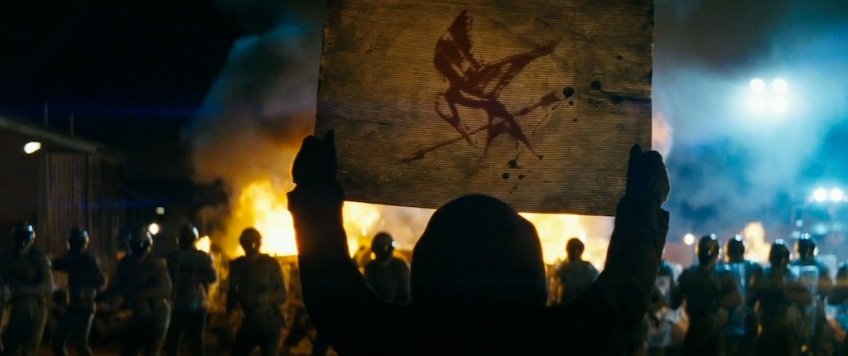 The Hunger Games Catching Fire Trailer Screenshot Mockingjay Symbol