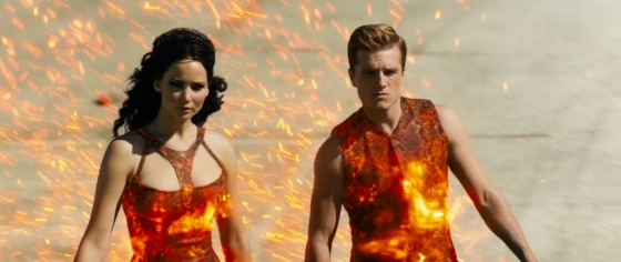 The Hunger Games Catching Fire Trailer Screenshot Tribute Avenue Attire District 12
