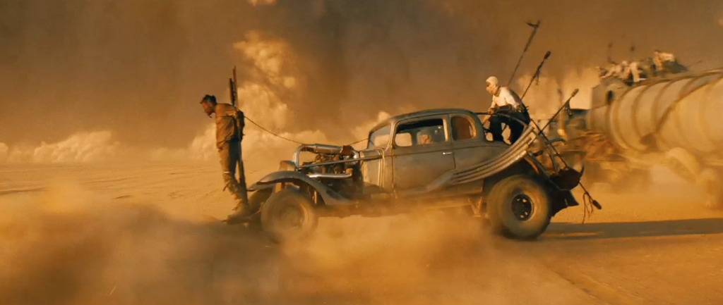 Mad Max Fury Road Screenshot Tom Hardy Tied to Car