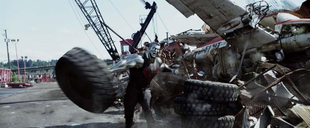 Deadpool Movie Screenshot Stefan Kapicic Colossus Tire Throw