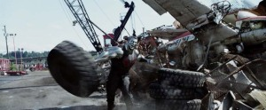 Deadpool Movie Screenshot Stefan Kapicic Colossus Tire Throw